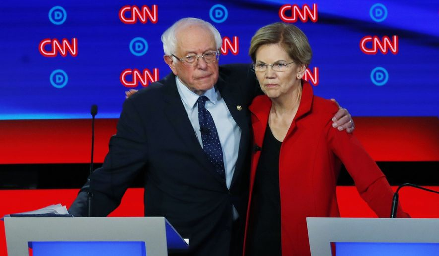 Sen. Bernie Sanders, I-Vt., and Sen. Elizabeth Warren, D-Mass., embrace after the first of two Democratic presidential primary debates in July, hosted by CNN in Detroit. (AP Photo/Paul Sancya) ** FILE **