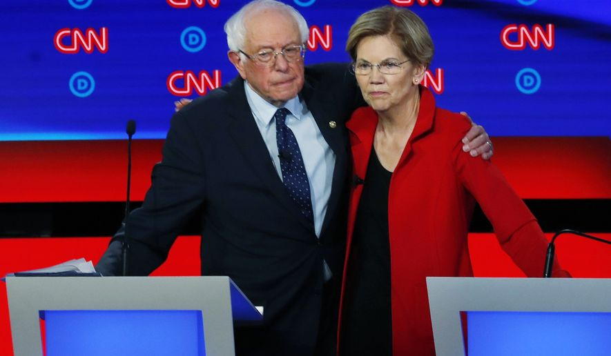 In this July 30, 2019, file photo, Sen. Bernie Sanders, I-Vt., and Sen. Elizabeth Warren, D-Mass., embrace after the first of two Democratic presidential primary debates hosted by CNN in the Fox Theatre in Detroit. (AP Photo/Paul Sancya)