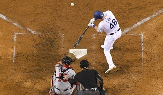 Los Angeles Dodgers' Gavin Lux hits a solo home run in the eighth inning against the Washington Nationals during Game 1 of baseball's National League Divisional Series on Thursday, Oct. 3, 2019, in Los Angeles. (AP Photo/Mark J. Terrill)