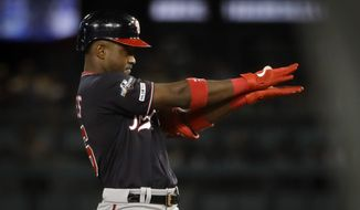 Washington Nationals' Victor Robles celebrates after a double against the Los Angeles Dodgers during the sixth inning in Game 2 of a baseball National League Division Series on Friday, Oct. 4, 2019, in Los Angeles. (AP Photo/Marcio Jose Sanchez)