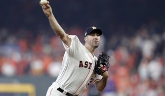 Houston Astros starting pitcher Justin Verlander (35) delivers a pitch against the Tampa Bay Rays in the first inning during Game 1 of a best-of-five American League Division Series baseball game in Houston, Friday, Oct. 4, 2019. (AP Photo/Michael Wyke)