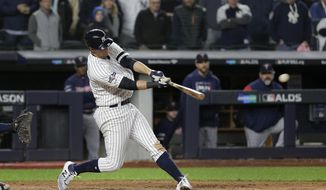 New York Yankees' DJ LeMahieu connects for a three-run double to left field against the Minnesota Twins during the seventh inning of Game 1 of an American League Division Series baseball game, Friday, Oct. 4, 2019, in New York. (AP Photo/Seth Wenig)