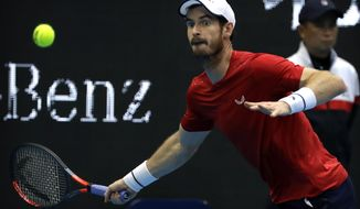 Andy Murray of Britain looks to hit a return shot while competing against Dominic Thiem of Austria in their quarterfinal match in the China Open tennis tournament in Beijing, Friday, Oct. 4, 2019. (AP Photo/Mark Schiefelbein)
