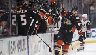Anaheim Ducks center Derek Grant is congratulated for his goal during the first period of the team's NHL hockey game against the Arizona Coyotes in Anaheim, Calif., Thursday, Oct. 3, 2019. (AP Photo/Kyusung Gong)