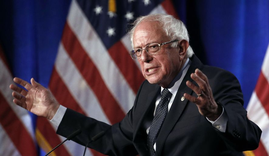 Democratic presidential candidate Bernard Sanders says Americans would happily pay higher taxes to fund his health care vision. (Associated Press/File)