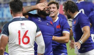 France's Jefferson Poirot, centre, celebrates after scoring a try during the Rugby World Cup Pool C game at Fukuoka Hakatanomori Stadium between France and the United States in Fukuoka, Japan, Wednesday, Oct. 2, 2019. France defeated the United States 33-9. (AP Photo/Christophe Ena)