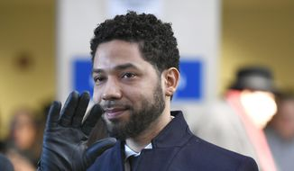 In this March 26, 2019, file photo, actor Jussie Smollett smiles and waves to supporters before leaving Cook County Court after his charges were dropped, in Chicago. (AP Photo/Paul Beaty) ** FILE **
