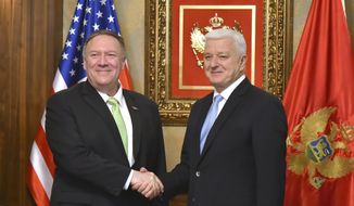 United States Secretary of State Mike Pompeo, left, shakes hands with Montenegro's Prime Minister Dusko Markovic, in Podgorica, Montenegro, Friday, Oct. 4, 2019. (AP Photo/Risto Bozovic)