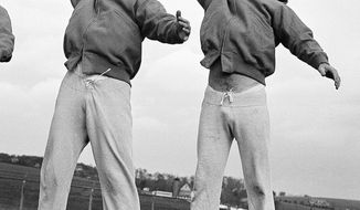 FILE - In this Nov. 4, 1949, file photo, Los Angeles Rams quarterbacks Bob Waterfield, left, and Norm Van Brocklin warm up at a practice session in Hershey, Pa. Waterfield was the NFL MVP in 1945 as a rookie while leading the Cleveland Rams to the championship. Then the former UCLA player got to go home to California when the franchise moved to Los Angeles following that title season. Waterfield was a three-time All-Pro and led the league in passing twice.  (AP Photo/File)