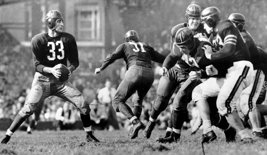 """In this Sept. 13, 1942, file photo, Washington Redskins quarterback Sammy Baugh, left, drops back to pass against the Chicago Bears during a football game in Washington. """"Slingin'"""" Sammy Baugh, Washington's top draft choice in 1937, gets credit for being the NFL's first big-yardage passer. (AP Photo/File)  **FILE**"""