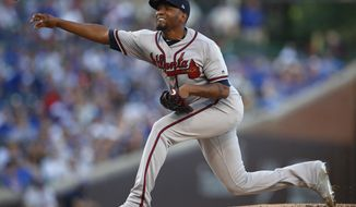 FILE - In this June 24, 2019, file photo, Atlanta Braves' Julio Teheran pitches against the Chicago Cubs during the first inning of a baseball game, in Chicago. The Atlanta Braves have been granted approval to replace injured reliever Chris Martin with Julio Teheran on their NL Division Series roster. Martin reported tightness in his left oblique while warming up for the eighth inning of Game 1 Thursday night, Oct. 3. (AP Photo/Jim Young, File)