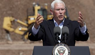 Vice President Mike Pence talks to the gathered employees of Caterpillar during a visit to the Tinaja Hills Demonstrations and Learning Center, Green Valley, Ariz., Thursday, Oct. 3, 2019. (Kelly Presnell/Arizona Daily Star via AP)