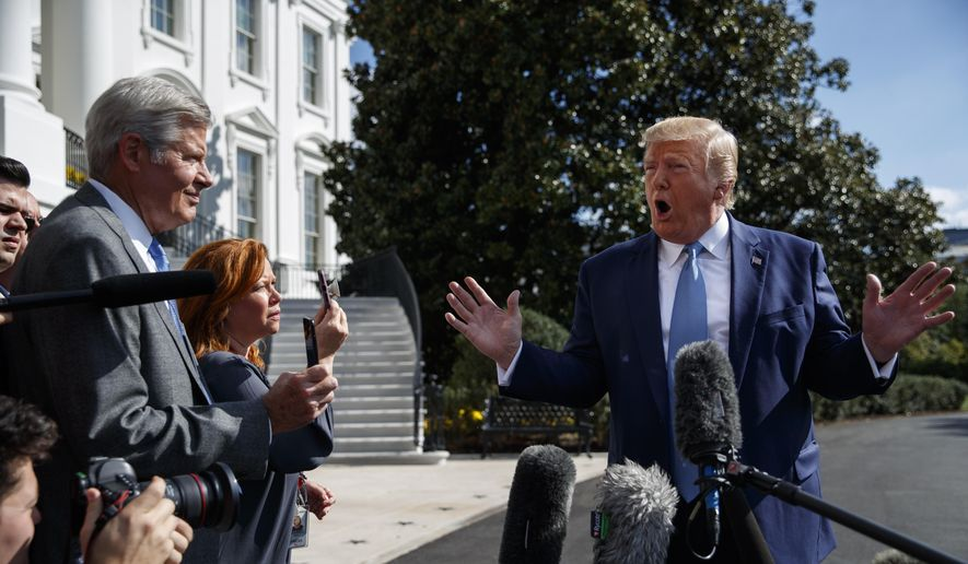 President Donald Trump talks to reporters on the South Lawn of the White House, Friday, Oct. 4, 2019, in Washington. (AP Photo/Evan Vucci)