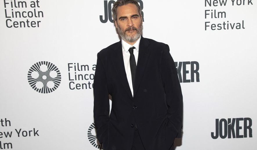 """Actor Joaquin Phoenix attends the """"Joker"""" premiere at Alice Tully Hall during the 57th New York Film Festival on Wednesday, Oct. 2, 2019, in New York. (Photo by Brent N. Clarke/Invision/AP)"""