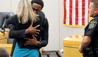 Brandt Jean hugs former Dallas Police Officer Amber Guyger. (Associated Press)