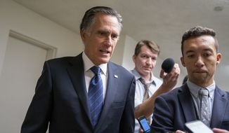 In this Sept. 11, 2019 file photo, Sen. Mitt Romney, R-Utah, takes questions from reporters as he arrives for votes on pending nominations, at the Capitol in Washington.  Romneys ratcheted-up rhetoric on President Donald Trump is again raising hopes among Trump detractors that the senator could play a key role in the unfolding impeachment saga, though the historic shifts in their relationship mean Romneys next move is an open question. (AP Photo/J. Scott Applewhite, File) **FILE**