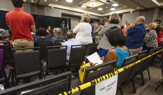 Members of the State Democratic Executive Committee give themselves a standing ovation after they voted on a new set of bylaws during a called meeting of the SDEC in Montgomery, Ala., on Saturday Oct. 5, 2019. (Mickey Welsh/Montgomery Advertiser via AP)