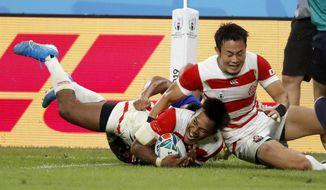 Japan's Kotaro Matsushima reacts after scoring a try during the Rugby World Cup Pool A game at City of Toyota Stadium between Japan and Samoa in Tokyo City, Japan, Saturday, Oct. 5, 2019. Japan defeated Samoa 38-19.(AP Photo/Shuji Kajiyama)