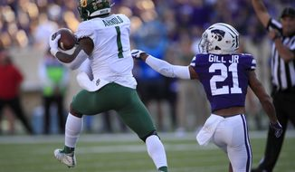 Baylor cornerback Grayland Arnold (1) intercepts a pass intended for Kansas State wide receiver Wykeen Gill (21) during the second half of an NCAA college football game in Manhattan, Kan., Saturday, Oct. 5, 2019. (AP Photo/Orlin Wagner)