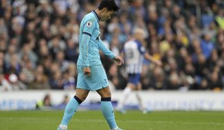 Tottenham's Son Heung-min is dejected after missing an opportunity to score during the English Premier League soccer match between Brighton and Hove Albion and Tottenham Hotspur at Falmer stadium in Brighton, England Saturday, Oct. 5, 2019. (AP Photo/Kirsty Wigglesworth)