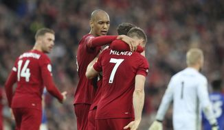 Liverpool's James Milner celebrates his wining goal during English Premier League soccer match between Liverpool and Leicester City in Anfield stadium in Liverpool, England, Saturday, Oct. 5, 2019. (AP Photo/Jon Super)
