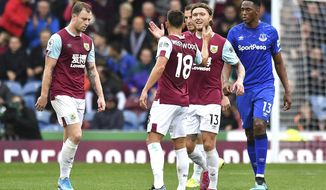 Burnley's Jeff Hendrick, centre right, celebrates scoring against Everton during the English Premier League soccer match at Turf Moor, Burnley, England, Saturday Oct. 5, 2019. (Anthony Devlin/PA via AP)