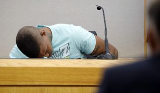 In this Tuesday, Sept. 24, 2019, file photo, Joshua Brown, a neighbor of victim Botham Jean, is overcome with emotion while giving testimony in court, in Dallas, after recounting how he'd heard Jean singing gospel and Drake songs across the hall before he was fatally shot. Authorities say that Brown was killed in a shooting Friday, Oct. 4. (Tom Fox/The Dallas Morning News via AP, Pool, File)