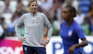 FILE - In this July 7, 2019, file photo, United States coach Jill Ellis, left, watches the players warm-up before the Women's World Cup final soccer match against the Netherlands at the Stade de Lyon in Decines, outside Lyon, France. The two-time FIFA women's coach of the year will lead the World Cup champions women's national team against South Korea in her final game before retiring on Sunday in Chicago.  (AP Photo/Francisco Seco, File)