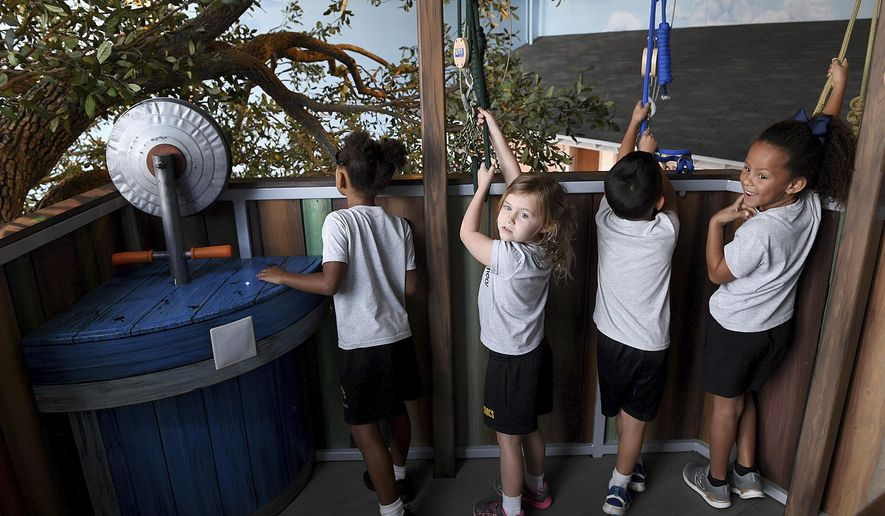 Children from St. Martha's School in Sarasota enjoyed a preview experience of the Bishop Museum's new Mosaic Backyard Universe. The new section will officially open on Oct. 1, 2019. (Tiffany Tompkins/The Bradenton Herald via AP)