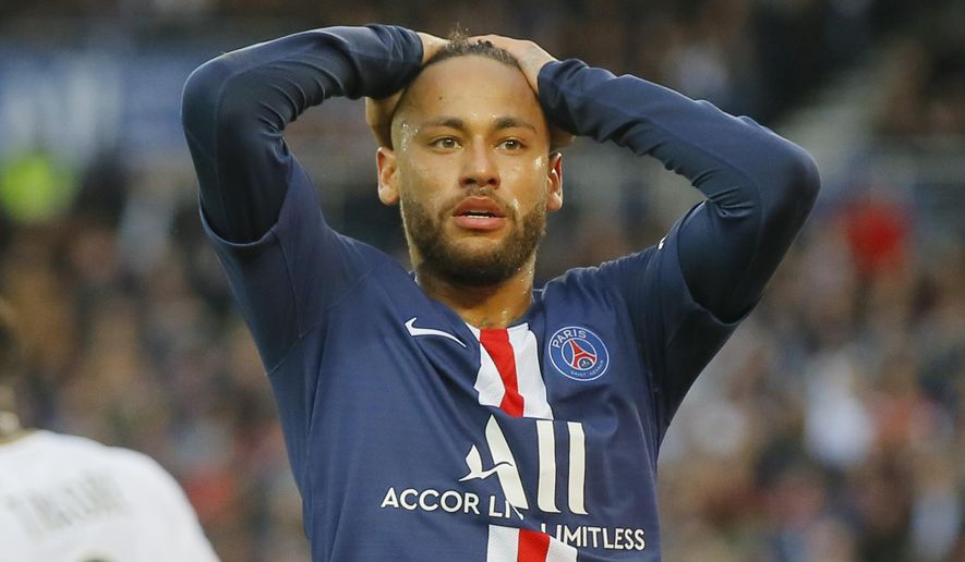 PSG's Neymar react after missing a goal opportunity during French League One soccer match between PSG and Angers at the Parc des Princes stadium in Paris, Saturday, Oct. 5, 2019. (AP Photo/Michel Euler)