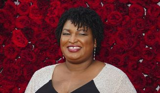 Former Georgia House Minority Leader Stacey Abrams poses for a photo on the red carpet at the grand opening of Tyler Perry Studios on Saturday, Oct. 5, 2019, in Atlanta. (Photo by Elijah Nouvelage/Invision/AP) ** FILE **
