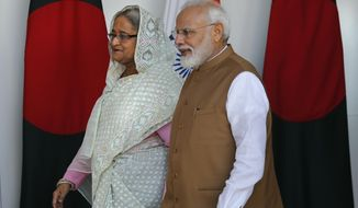 Indian Prime Minister Narendra Modi, right, and his Bangladeshi counterpart Sheikh Hasina arrive for a delegation level meeting in New Delhi, India, Saturday, Oct. 5, 2019. Hasina arrived in India on Thursday for a visit during which she is expected to sign agreements on increasing trade and investment and improving regional connectivity. (AP Photo/Manish Swarup)