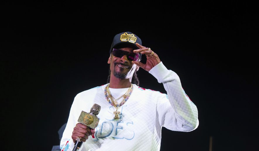 """FILE - In this Jan. 5, 2019 file photo, Snoop Dogg performs onstage at State Farm Arena in Atlanta. The University of Kansas has apologized for its risque Late Night at the Phog event in which the rapper performed, stripper poles were wheeled onto the Allen Fieldhouse floor and fake money was shot over the heads of prospective recruits. Athletic director Jeff Long said Friday, Oct. 4  """"we expected a clean version of the show."""" Long said in a statement the school fell short of providing a """"family atmosphere"""" during the annual kickoff for the school's beloved basketball program. (Photo by Paul R. Giunta/Invision/AP, File)"""