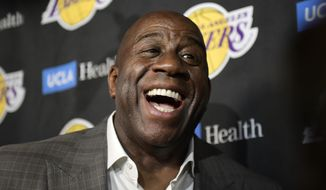 In this April 9, 2019, file photo, Magic Johnson speaks to reporters prior to an NBA basketball game between the Los Angeles Lakers and the Portland Trail Blazer in Los Angeles. (AP Photo/Mark J. Terrill, File)