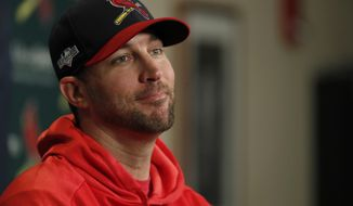St. Louis Cardinals starting pitcher Adam Wainwright listens to a question during a news conference at the baseball National League Division Series Saturday, Oct. 5, 2019, in St. Louis. Wainwright is expected to start when the Cardinals play Game 3 of the series against the Atlanta Braves on Sunday in St. Louis. (AP Photo/Jeff Roberson)