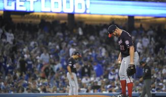 Washington Nationals starting pitcher Stephen Strasburg kicks the mound after a single by Los Angeles Dodgers' Will Smith that broke up his perfect game during the fifth inning in Game 2 of a baseball National League Division Series on Friday, Oct. 4, 2019, in Los Angeles. (AP Photo/Mark J. Terrill)