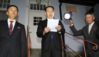 "North Korean negotiator Kim Miyong Gil, center, reads statement outside the North Korean Embassy in Stockholm, Sweden, Saturday, Oct. 5, 2019. North Korea's chief negotiator said Saturday that discussions with the U.S. on Pyongyang's nuclear program have broken down, but Washington said the two sides had ""good discussions"" that it intends to build on in two weeks. (Kyodo News via AP)"