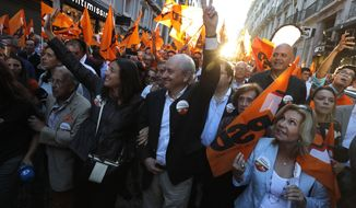 Rui Rio, leader of the Social Democratic Party, center, gestures during an election campaign action in downtown Lisbon Friday, Oct. 4, 2019. Portugal will hold a general election on Oct. 6 in which voters will choose members of the next Portuguese parliament. (AP Photo/Armando Franca)