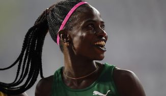 Tobi Amusan of Nigeria smiles after finishing a women's 100 meter hurdles heat at the World Athletics Championships in Doha, Qatar, Saturday, Oct. 5, 2019. (AP Photo/Petr David Josek)