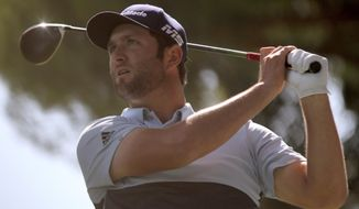 In this Friday, Oct. 4, 2019 photo Spain's Jon Rahm competes during the second round of the Spanish Open golf tournament in Madrid, Spain. Jon Rahm shot an 8-under 63 on Saturday to match the course record and take a commanding five-shot lead entering the final round of the Spanish Open. (AP Photo/Tales Azzoni)
