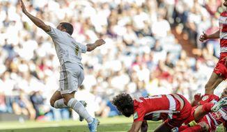 Real Madrid's Eden Hazard celebrates after scoring during the Spanish La Liga soccer match between Real Madrid and Granada at the Santiago Bernarbeu stadium in Madrid, Saturday, Oct. 5, 2019. (AP Photo/Bernat Armangue)
