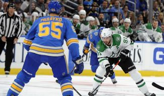 Dallas Stars' Tyler Seguin (91) looks to pass around St. Louis Blues' Colton Parayko (55) during the first period of an NHL hockey game, Saturday, Oct. 5, 2019, in St. Louis. (AP Photo/Bill Boyce)