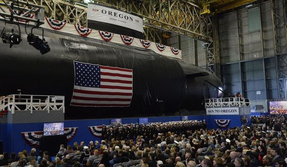 The U.S. Navy's newest attack submarine, the future USS Oregon, is christened in a ceremony at Electric Boat in Groton, Conn., on Saturday, Oct. 5, 2019. Politicians, shipyard leaders and Navy officials gathered for the ceremony at the General Dynamics Electric Boat shipyard, where they spoke about the importance of Virginia-class submarines and praised the skills of the thousands of shipyard workers in Connecticut, Rhode Island and Virginia who built the Oregon. (Dana Jensen/The Day via AP)