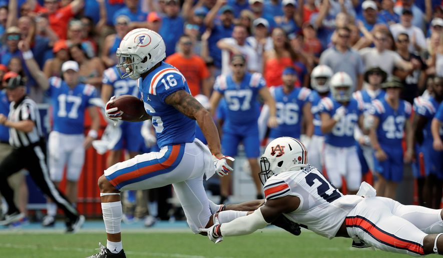 Florida receiver Freddie Swain runs for a 64-yard touchdown in a win over Auburn. Florida moved up three spots in the Top 25 to No. 7 with the victory. (ASSOCIATED PRESS)