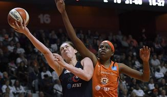 Washington Mystics' Emma Meesseman, left, drives for a lay up past Connecticut Sun's Jonquel Jones during the second half in Game 3 of basketball's WNBA Finals, Sunday, Oct. 6, 2019, in Uncasville, Conn. (AP Photo/Jessica Hill) ** FILE **