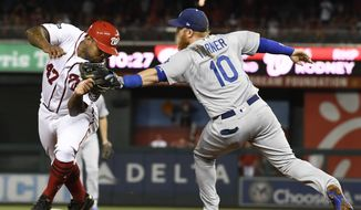 Washington Nationals Howie Kendrick (47) is tagged out by Los Angeles Dodgers third baseman Justin Turner (10) during the sixth inning in Game 3 of a baseball National League Division Series on Sunday, Oct. 6, 2019, in Washington. (AP Photo/Susan Walsh) ** FILE **