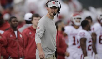 Oklahoma head coach Lincoln Riley watches during the first half of an NCAA college football game against Kansas Saturday, Oct. 5, 2019, in Lawrence, Kan. (AP Photo/Charlie Riedel)
