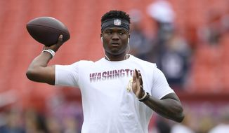 Washington Redskins quarterback Dwayne Haskins warms up ahead of an NFL football game between the Washington Redskins and the New England Patriots, Sunday, Oct. 6, 2019, in Washington. (AP Photo/Nick Wass) **FILE**
