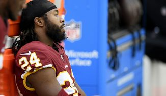 Washington Redskins cornerback Josh Norman (24) sits on the bench during the late second half of an NFL football game against the New England Patriots, Sunday, Oct. 6, 2019, in Washington. The New England Patriots won 33-7. (AP Photo/Nick Wass) ** FILE **