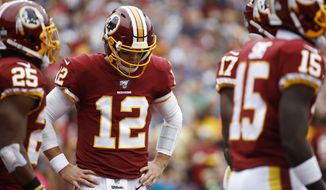 Washington Redskins quarterback Colt McCoy (12) works against the New England Patriots during the first half of an NFL football game, Sunday, Oct. 6, 2019, in Washington. (AP Photo/Patrick Semansky)
